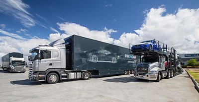Prixcar trucks transporting cars
